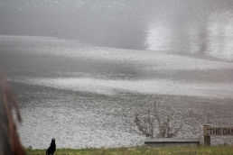 A Winter storm lashes the dam surface