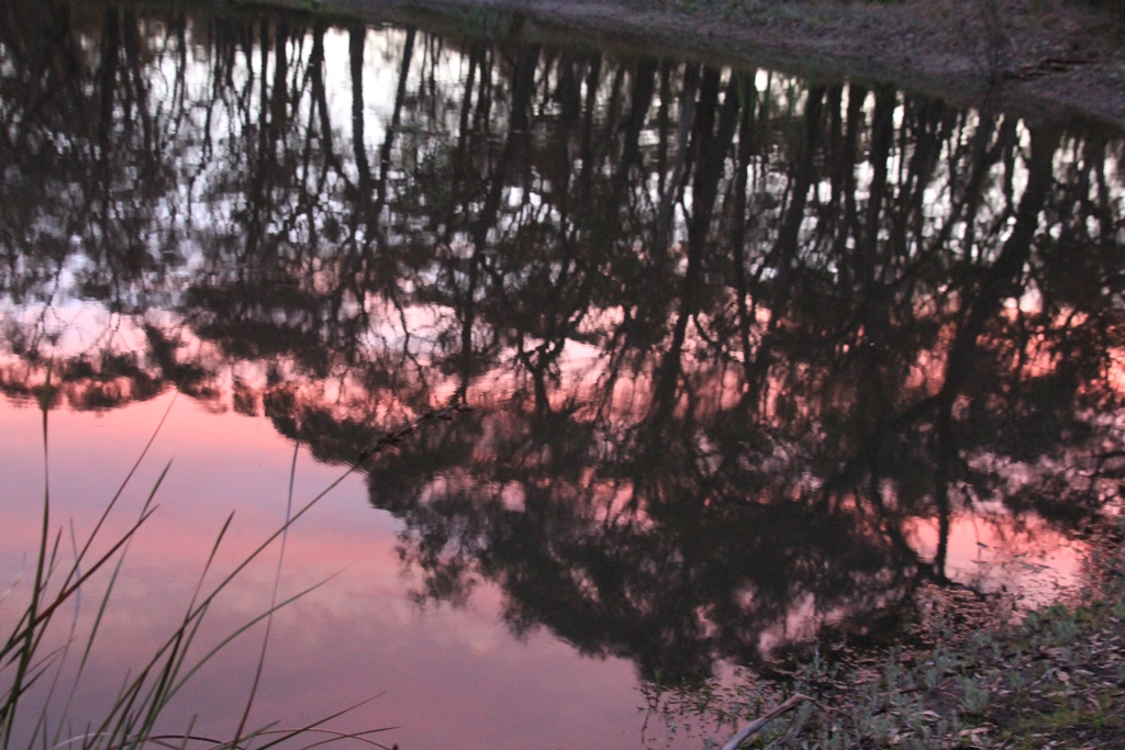 Sunset reflected on the surface of the dam